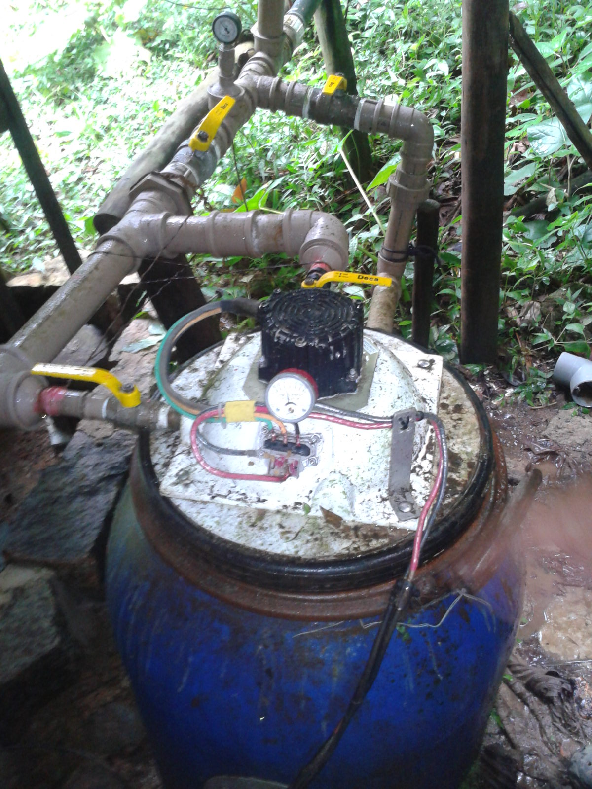 water from the stream above the settlement is led in pipes to this simple turbine.