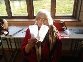 Journalist BirGitta Tornerhielm shows off her vouchers for ITK